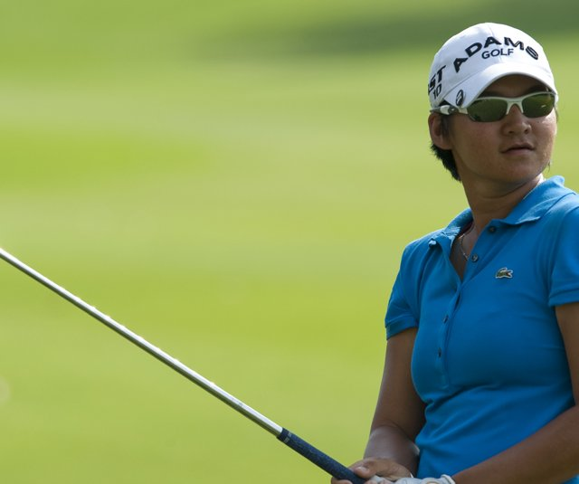 Yani Tseng plays her second shot on the 14th hole during the LPGA Thailand at Siam Country Club.