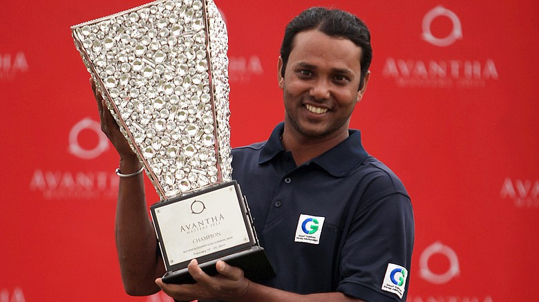 S.S.P. Chowrasia of India holds the trophy after winning Avantha Masters on Feb. 20, 2011, in New Delhi, India.