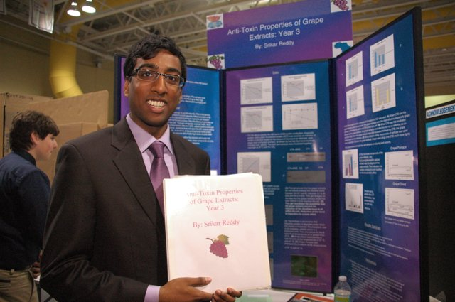 Srikar Reddy, 17, shows off his study of the anti-toxin properties of grape extracts, a science project he's been conducting for three years. Rollins College hosted the Orange County Science Fair on Feb. 14, giving budding scientists a chance to show off their research.