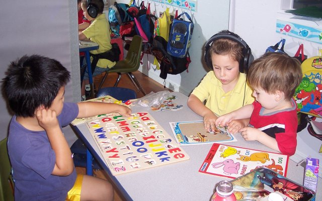 From left, Jae, 4, J.D., 4, and Trent, 3, work on puzzles and listen to music at A.LL Therapy Connection in Maitland.