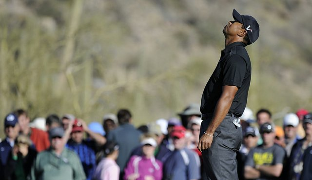 Tiger Woods reacts to his missed putt on the 17th hole during the first round of the World Golf Championships Accenture Match Play Championship.