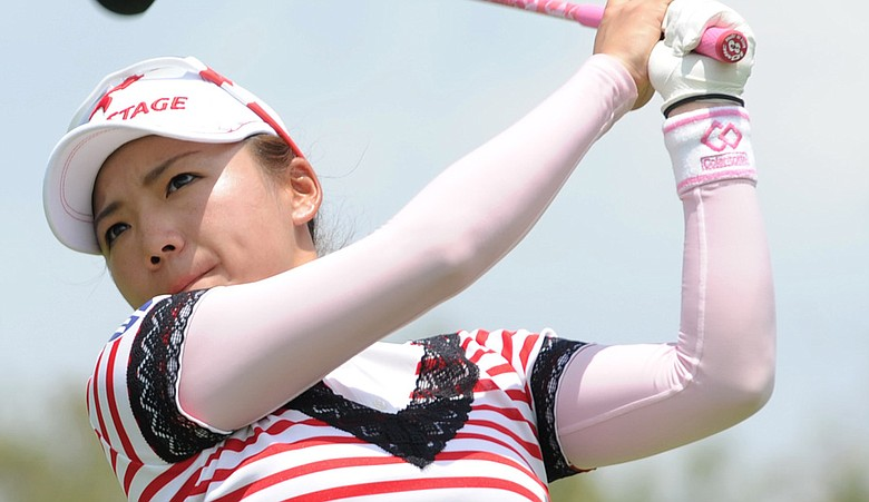 Chie Arimura tees off on the 12th hole during the first round of the HSBC Women's Champions in Singapore.