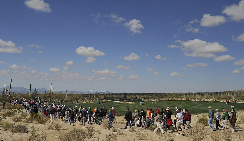 Fans cross the fifth fairway during the second round of the Accenture Match Play Challenge.
