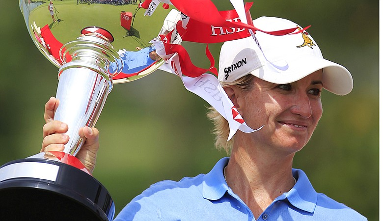 Karrie Webb celebrates with her trophy after winning the HSBC Women's Champions, Sunday Feb. 27, 2011 in Singapore.