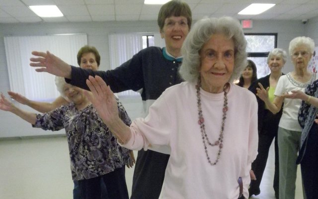 Pauline Dolinky, front, demonstrates some line dancing steps for her students before starting the song at the Azalea Lane Recreation Center in Winter Park.
