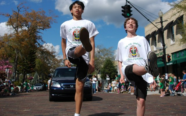Students from Tir Na Graene School of Irish Dance show off their skills on the street during Winter Park's St. Patrick's Day parade.
