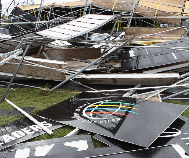 The main leaderboard is seen in pieces after high winds swept the golf course after play was suspended due to dangerous weather during the first round of the 2011 WGC- Cadillac Championship at the TPC Blue Monster at the Doral.