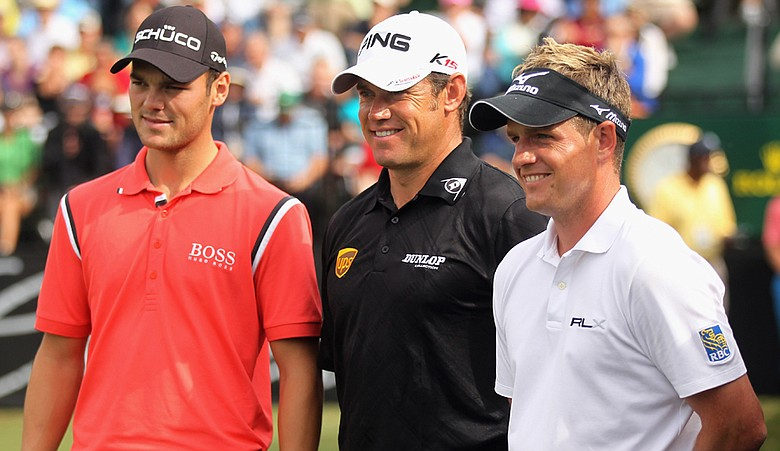 Martin Kaymer, left, Lee Westwood, center, and Luke Donald, the top-ranked players in the world, pose on the first tee during the first round of the 2011 WGC-Cadillac Championship.