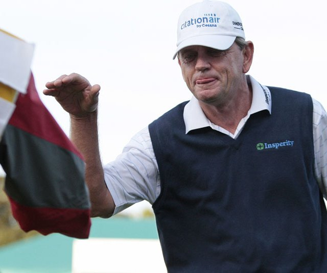Nick Price shakes hands with Bernard Langer&#39;s caddie after the second round of the Toshiba Classic.