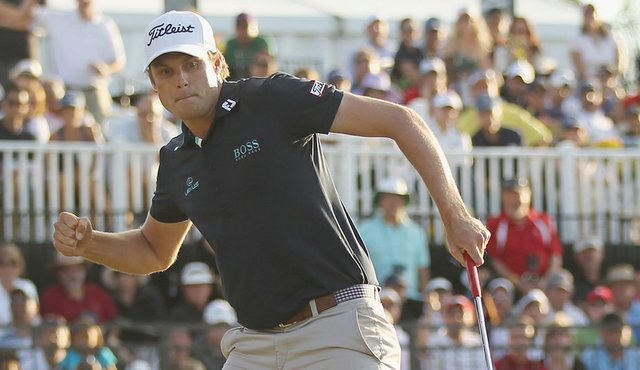 Nick Watney celebrates his birdie putt on the 18th green during the final round of the 2011 WGC-Cadillac Championship at the TPC Blue Monster at the Doral Golf Resort and Spa.
