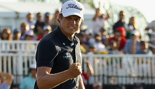 Nick Watney celebrates his birdie putt on the 18th green during the final round of the 2011 WGC- Cadillac Championship.