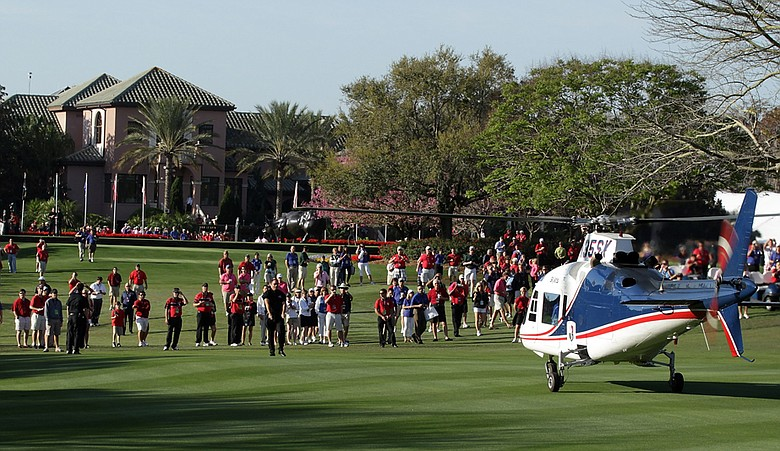 Players arrive by helicopter on the first fairway before the first round of the 2011 Tavistock Cup at Isleworth Golf Club.