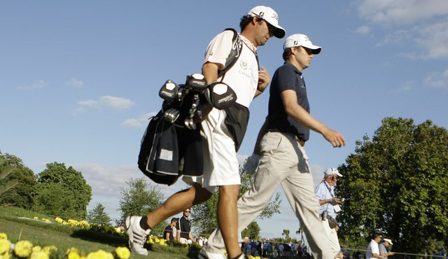 Nick Watney (right) with his caddie Chad Reynolds at Doral.