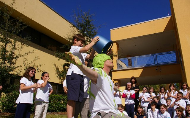 Ben Perreault dumps a bucket of slime on a teacher. Jewish Academy of Orlando students slimed science teacher and athletics coach Sean Bowmer for surpassing their goal of money raised for Jump Rope for Heart. The slime was made in science class by the school's third-graders.