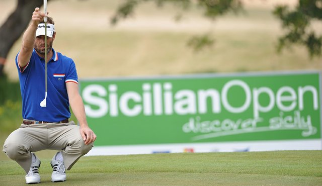 Raphael Jacquelin of France lines up his putt on the eighth hole during the third round of the Sicilian Open at the Donnafugata golf resort and spa on March 19, 2011 in Ragusa, Italy.