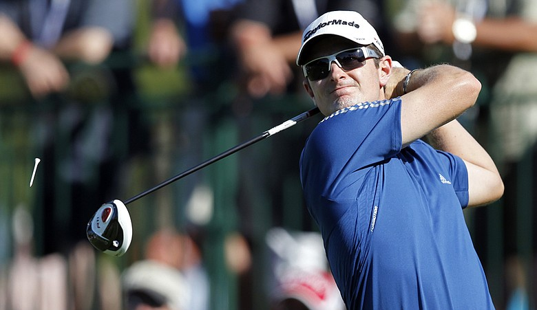 Justin Rose tees off on the 18th hole during the third round of the Transitions Championship golf tournament Saturday, March 19, 2011, in Palm Harbor, Fla.