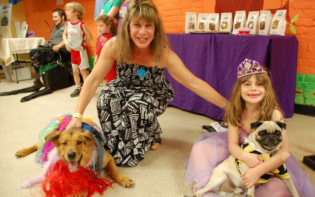 Caryn and Alexa Coultoff with dogs Jack and Johnny at the Roth Jewish Community Center's Second Annual Pawrim Doggie Celebration.