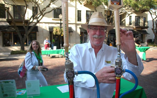 Orlando Brewing Company President John Cheek pours a pint at The Hannibal Square Wine Tasting & St. Patrick's Day Street Party on March 17 on New England Avenue.