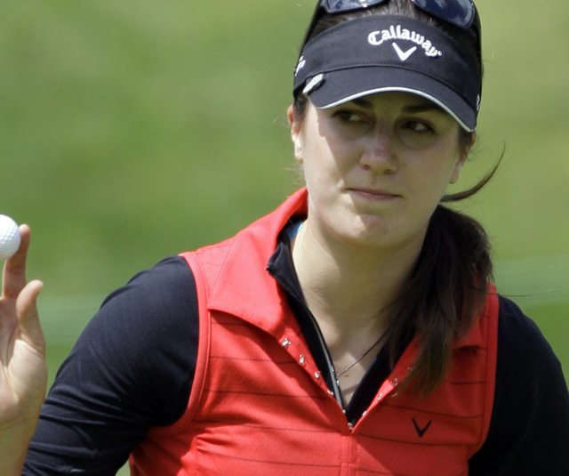 Sandra Gal, of Germany, makes par on the first hole in the final round of the LPGA Kia Classic golf tournament at Industry Hills Golf Club in Industry, Calif., Sunday, March 27, 2011. 