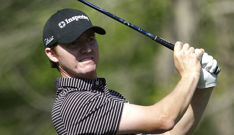 Jimmy Walker watches his tee shot on the second hole during the first round of the Houston Open on Thursday, March 31, 2011, in Humble, Texas.