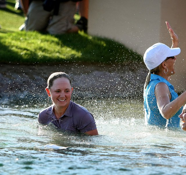 Stacy Lewis and her family celebrate in Poppie&#39;s Pond after she won during the final round of the the 2011 Kraft Nabisco Championship.