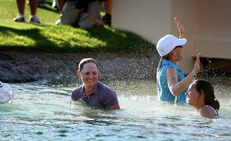 Stacy Lewis and her family celebrate in Poppie's Pond after she won during the final round of the the 2011 Kraft Nabisco Championship.