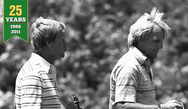 Jack Nicklaus, left, and Greg Norman carry their putters as they leave the green during practice round on June 11, 1986 at the U.S. Open in Southampton, New York. Norman was the runner-up to Nicklaus' in this year's Masters tournament.