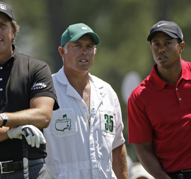 Phil Mickelson, caddie Steve Williams and Tiger Woods at the 2009 Masters.