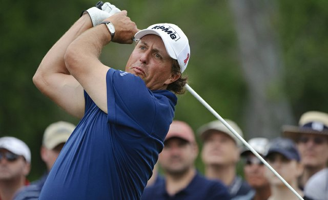 Phil Mickelson tees off the third hole during the final round of the Houston Open golf tournament, Sunday, April 3, 2011, in Humble, Texas.