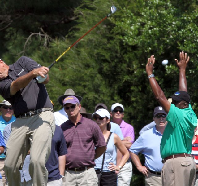 Fans watch as Tom Lehman drives his ball toward first hole at the Mississippi Gulf Resort Classic at Fallen Oak Saturday. The first shot by Lehman sent fans scurrying as it sailed off of the fareway and into the crowd.
