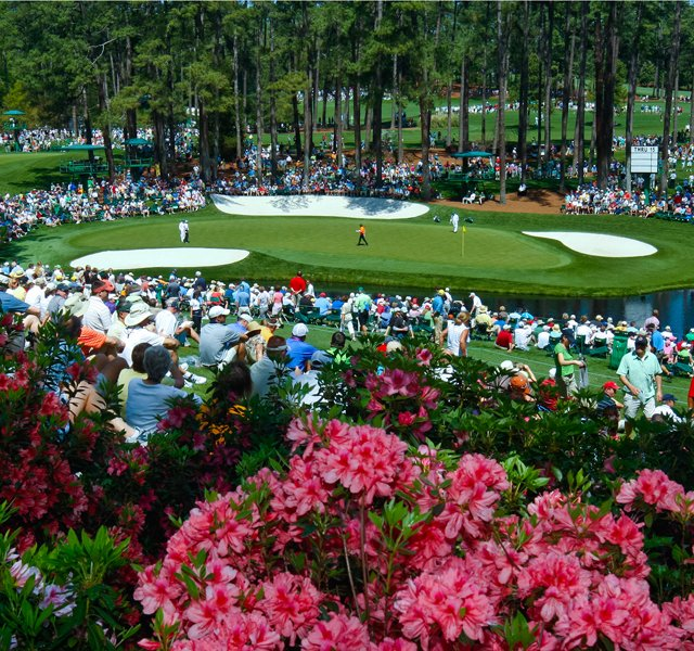 Fans wait around the par-3 16th hole at Augusta National during Monday&#39;s practice round. 