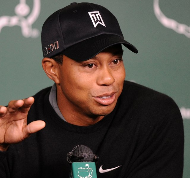 Tiger Woods speaks to the media during a press conference prior to the 2011 Masters.