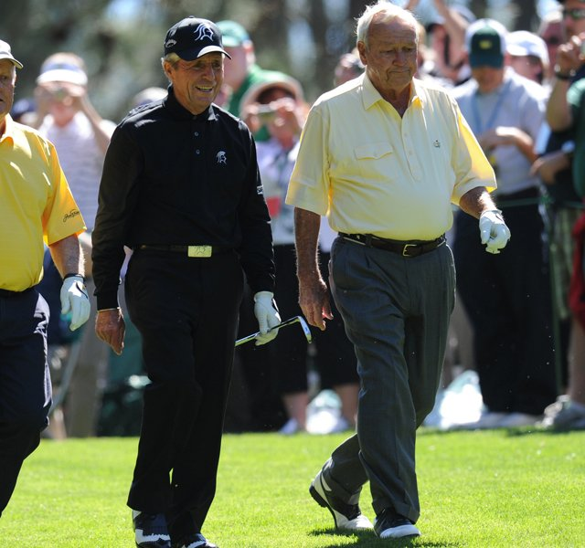 Jack Nicklaus, of the US, Gary Player of South Africa and Arnold Palmer of the US walk down the fairway during the par 3 contest prior to the Masters golf tournament at Augusta National Golf Club on April 6, 2011 in Augusta, Georgia.