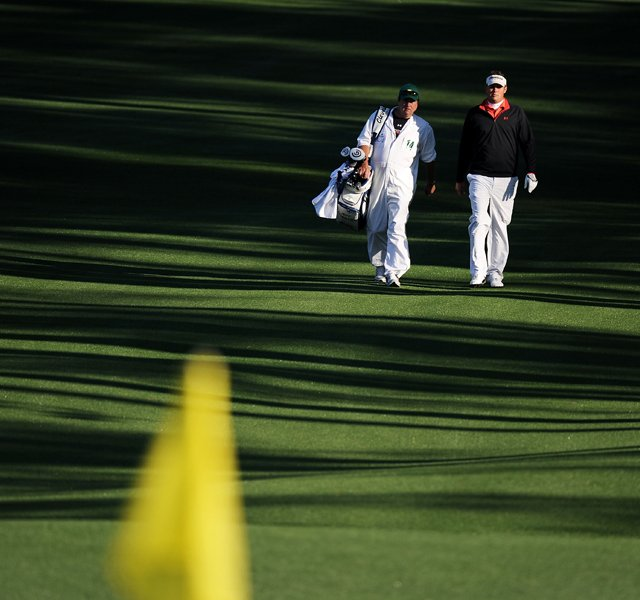 Jeff Overton walks up the second fairway with his caddie Eric Larson during the first round of the 2011 Masters Tournament at Augusta National Golf Club on April 7, 2011 in Augusta, Georgia.