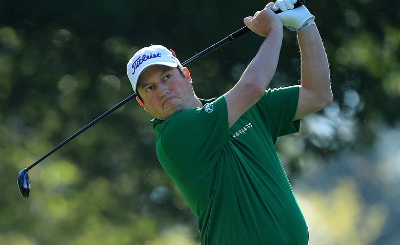Tim Clark of South Africa watches his tee shot on the fourth hole during the first round of the 2011 Masters Tournament at Augusta National Golf Club on April 7, 2011 in Augusta, Georgia.