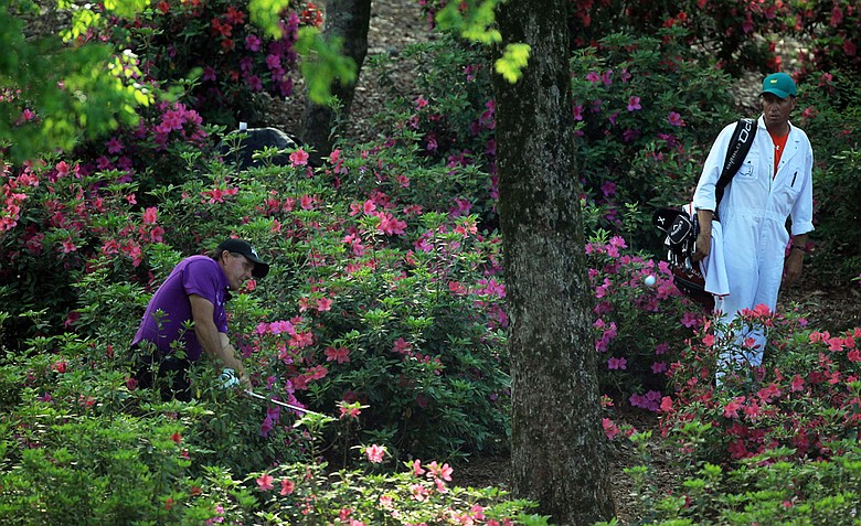 Phil Mickelson plays his second shot from the flowers on the 13th hole during the first round of the 2011 Masters Tournament at Augusta National Golf Club on April 7, 2011 in Augusta, Georgia.