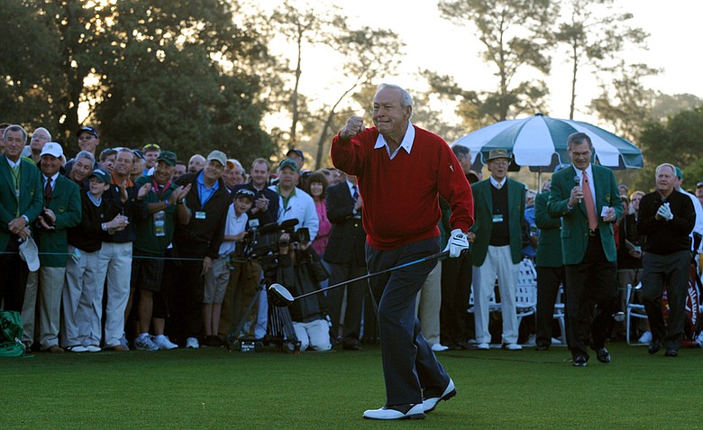 Legendary golfer Arnold Palmergestures after hitting his ceremonial tee shot during the first round of the Masters golf tournament at Augusta National Golf Club on April 7, 2011 in Augusta, Georgia.