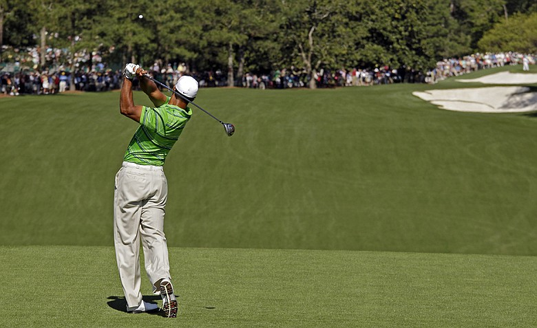 Tiger Woods tees off at the first hole during the first round of the Masters golf tournament Thursday, April 7, 2011, in Augusta, Ga.