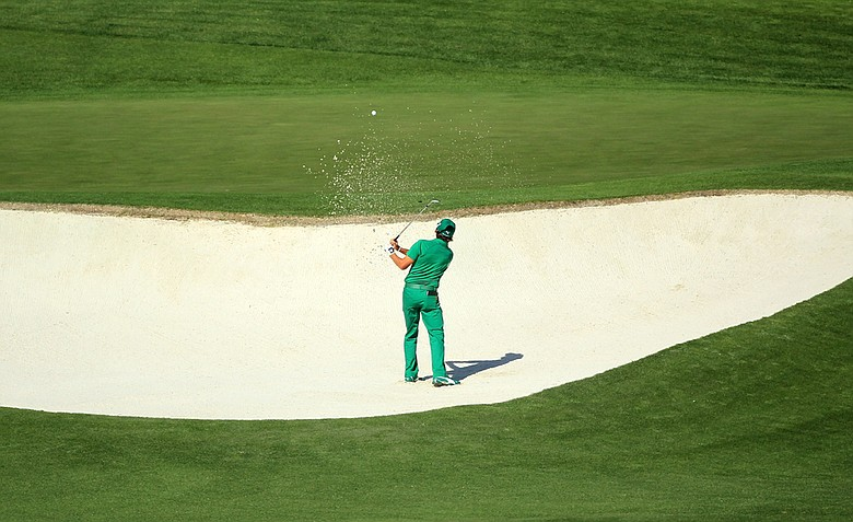 Rickie Fowler hits from a bunker on the fourth hole during the first round of the 2011 Masters.
