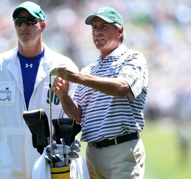 Fred Couples talks with his caddie Joe LaCava on the first hole during the first round of the 2011 Masters Tournament. LaCava has also worked for Dustin Johnson and will reportedly move to Tiger Woods&#39; bag.
