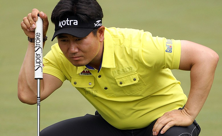 Y.E. Yang of South Korea lines up a putt on the ninth green during the second round of the 2011 Masters Tournament at Augusta National Golf Club on April 8, 2011 in Augusta, Georgia.