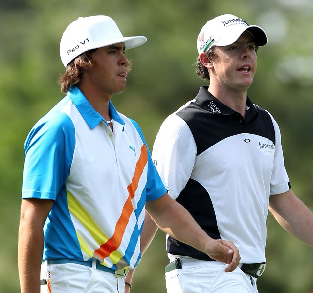 Rickie Fowler and Rory McIlroy walk up the 14th hole together during the second round of the 2011 Masters.