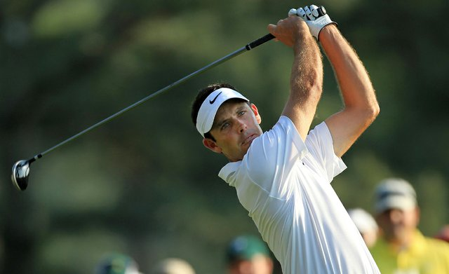 Charl Schwartzel watches his tee shot on the 18th hole during the third round of the 2011 Masters.