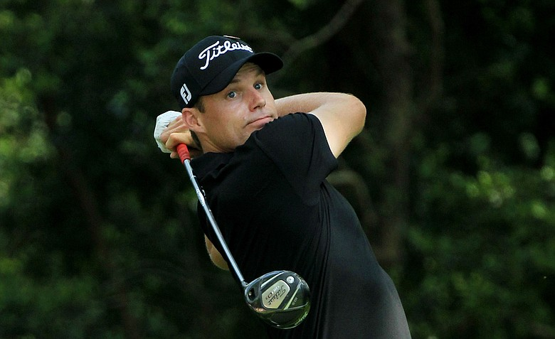 Nick Watney watches his tee shot on the second hole during the third round of the 2011 Masters.