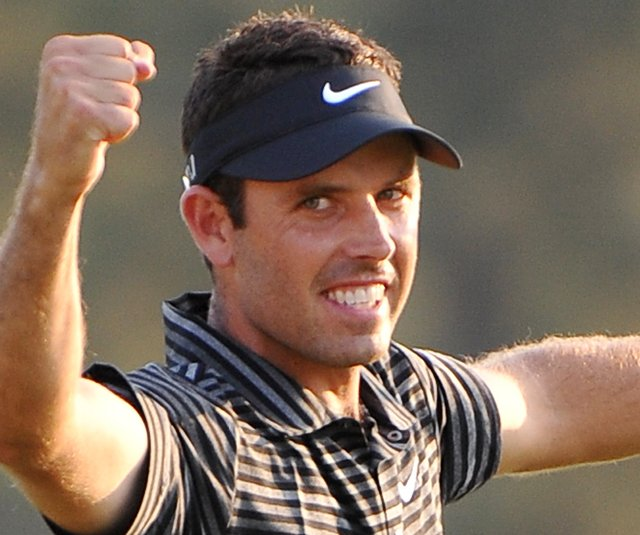 Charl Schwartzel smiles on the 18th green after winning the 2011 Masters.