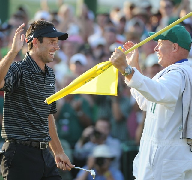 Charl Schwartzel high fives his caddie Greg Hearmon after winning the Masters on Sunday.