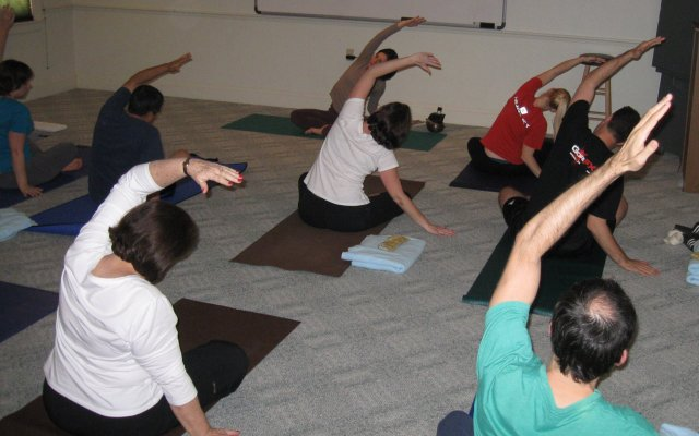 Faith community nurse Kendra Otero participates in Wednesday yoga class with her First Congregational Church family after a healthy Lenten supper of soup and salad.