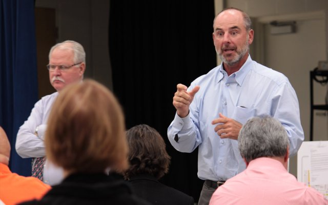 Developer Dan Bellows responds to questions brought to his attention by concerned neighboring residents of the Ravaudage project in a community meeting Tuesday, April 12.