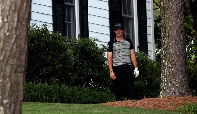 Rory McIlroy waits on the 10th hole after an errant tee shot during the final round of the 2011 Masters.