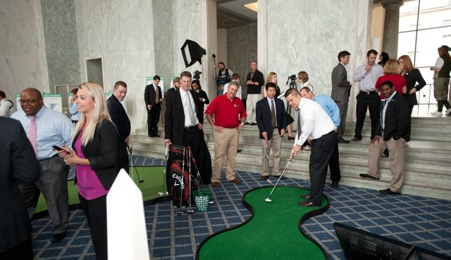 Attendees taking part in the We Are Golf exhibit in the Rayburn Foyer during the observance of National Golf Day in Washington, D.C., on Wednesday, April 13th, 2011.
